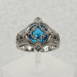 Sterling Silver Caged Blue Ring